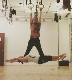 Dead hang on gymnastics rings with my girlfriend hanging off me.  Saw a pic a few weeks ago of this and had to have a go.