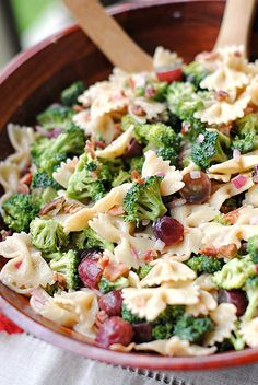Broccoli Grape Harvest Salad - 8 servings - 1/2 (16 oz) box whole wheat farfalle (bow-tie) pasta, 1 lb. fresh broccoli, 1/2 cup light mayonnaise, 1/2 cup non-fat plain yogurt, 1/3 cup sugar, 1/3 cup diced red onion, 1/3 cup red wine vinegar, 1 tsp. salt, 2 cups seedless red grapes, 6 cooked turkey bacon slices, crumbled,1/4 cup chopped pecans.