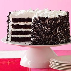Chocolate cake layered with a cream cheese filling and topped with a creamy vanilla frosting make up this eye-catching dessert. A sprinkling of crushed chocolate sandwich cookies make it a kid-favorite recipe.