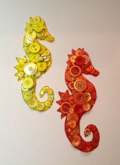 # button art. Seahorses using rhinestones and buttons, some of which are vintage ones.