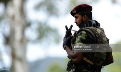 A Sri Lankan special forces commando stands guard during a ceremony for the graduation of 140 new army officers where Secretary to Sri Lankan President Mahinda Rajapakse, Lalith Weeratunga was the chief guest in the island's central district town of Diyatalawa on July 2, 2012. Sri Lanka continues to recruit military personnel, after government forces defeated the Tamil Tiger rebels and ended 37-years of ethnic bloodshed in May 2009. AFP PHOTO/Ishara S. KODIKARA