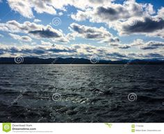 Light on the Shore stock image. Image of bright, puffy - 71102385 Adirondack Mountains, Lake Champlain, Photo Lighting, Windy Day, Vermont, Clouds, Stock Photos, Beach, Water