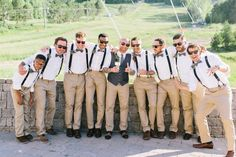 a huge trend for men is to separate the groom from the groomsman, in a small way, and have the pants and shirt match. this grooms vest, shoes and matching tie to his groomsman's bow ties is the perfect combination!