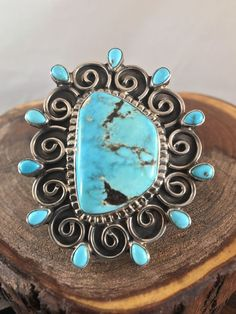 NAVAJO ~THIS RING IS MADE BY TONYA JUNE RAFAEL. SHE ONLY MAKES ONE OF A KIND PIECES. THE RING HAS A MIDDLE STONE OF KINGMAN TURQUOISE SURROUNDED BY SMALLER STONES OF SLEEPING BEAUTY TURQUOISE. ITS AMAZING ! | eBay!