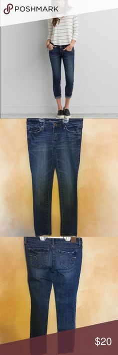 AMERICAN EAGLE SKINNY CROP JEANS CONDITION: Nearly New Condition  COLOR: Dark WASH SIZE: 2 short WAIST: 15 1/2 INSEAM: 29 MATERIAL: 99%cotton 1%spandex American Eagle Outfitters Jeans Ankle & Cropped