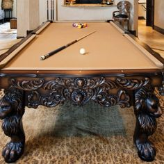 Billiards Table. I'm mostly looking at the legs and beautiful carvings. Not too fond of the felt color.