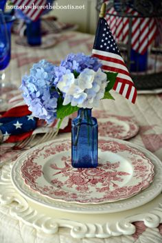 Patriotic table celebrating the Red, White & Blue with Crown Ducal Bristol and blue bottles with hydrangeas and flags! #july4th #patriotic