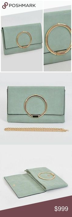 """Arriving soon! Mint buckle clutch Simple yet classy clutch with large round metallic buckle closure and metallic shoulder strap included. 12""""W X 8""""H X .5""""D. Polyurethane, mixed metal. Color mint. Price: $20. Bags Clutches & Wristlets"""