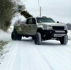 Duramax diesel chevy Silverado rolling coal in snow Chevy Trucks, Jacked Up Trucks, Dually Trucks, Pickup Trucks, Chevy Silverado, Chevy Duramax, Dodge Cummins, Dodge Diesel, Chevy Bronco
