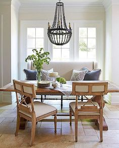 Love this breakfast nook with a pretty chandelier and a settee
