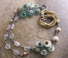 Awesome necklace tutorial featuring Roman glass, I may need to make one for myself.