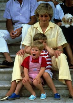 Princess Diana sat with Prince Harry and Prince William while on vacation in Majorca, Spain, in August 1987.