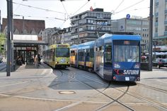 Two Trams in Braunschweig, Germany. The left one is an 1981 high-floor tram, the right one a 2007 low-floor