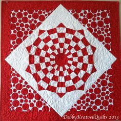 """Vortex quilt made with a regular, 20 wedge Dresden Plate ruler with an 8"""" height.with some amazing dots to set it on point!"""
