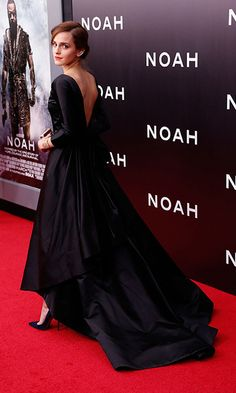 Emma Watson: The former Harry Potter star revamped the meaning of the LBD, stepping out to a Noah film premiere in a long-sleeved black satin gown. Emma exuded old Hollywood glamour in the Oscar de la Renta Fall 2014 dress, showing off its low back and ruffled train as she strutted down the red carpet. Photo: © Getty Images