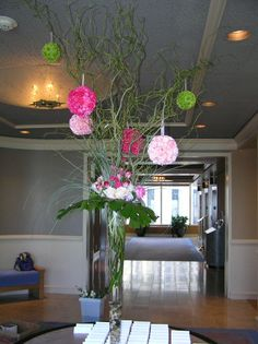 Hanging Pomander Balls and Curly Willow with Pave Arrangement at the rim of the vase greet guests at the Reception Entrance