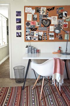 "Sneak Peek: A Seaside California Home Layered with Inspiration. ""This is one of my favorite corners of our home because it is where my creativity thrives. If I am sitting in that chair, that means I am hard at work creating something. The cork board holds mementos of trips, inspirational photos, sweet cards from friends and invitations we've has designed. The desk is Ikea- but I tampered with the legs to give a sleeker look. The shell chair was a gift from Chris."" #sneakpeek"