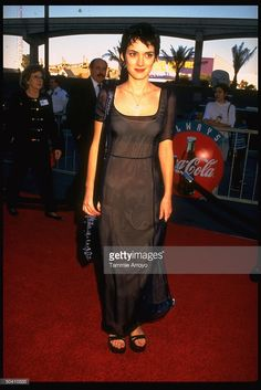 Actress Winona Ryder wearing simple black and blue sheer layered Prada dress at the 1997 NATO ShoWest Awards.