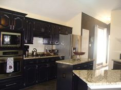 Kitchen with black cabinets. Leaning now towards white cabinets. Decorations pop more with white cabinets.