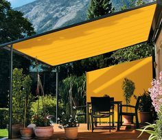 Large fixed awning used as a shade panel. This is a clever look for a modern home and may be even cheaper than a shaded wood Patio Cover.