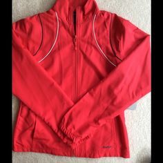 ❤️REEBOK WIND JACKET❤️ Sporty Reebok windbreaker.  The lightweight design protects you from breezy conditions but won't weigh you down.  Stretchy cuffs hold sleeves in place.  100% polyester.  Pretty red color.  Size small.  NEW WITH TAGS. Reebok Jackets & Coats