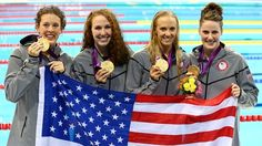 Allison Schmitt, Dana Vollmer, Shannon Vreeland and Missy Franklin (L-R) pose with their gold medals following the 4x200m freestyle relay medal ceremony