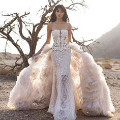 This crystal embellished #WindUponWater corset is a total showstopper! What do you think of this detachable train ?