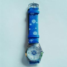 NWOT - Blue Avon Snowflake Watch NWOT - Blue Avon Snowflake Watch. Never worn. It's not bended, still perfectly straight. Bought from Avon. Has cute snowflake detail. In need of new batteries. I no longer have the box. There is a bit of glue residue on the back (third picture). Not noticeable when worn since it's on the inside. It has a stainless steel back and seven holes to get the right fit. Avon Accessories Watches