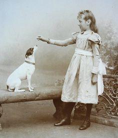 Girl feeding her dog by J. Wentzel c.1900  Courtesy of Jan Weijers