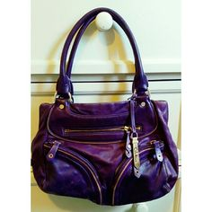 Beautiful Purple Leather Cole Haan purse! This leather bag is very fancy and cute. It's a deep purple wirh multiple pouches and zippers. Gently used! Cole Haan Bags Shoulder Bags
