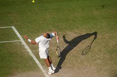 Nick Kyrgios reaches for a serve