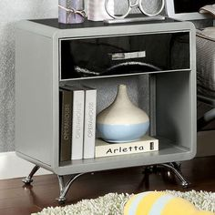 "Otis $133  NIGHT STAND    |    CM7165N This contemporary night stand offers great style and durability, with unique metal tones in black and finished in silver. Contemporary Style Silver & Black Arched Legs Night Stand: 21 1/8""W X 15 3/4""D X 24 5/8""H"