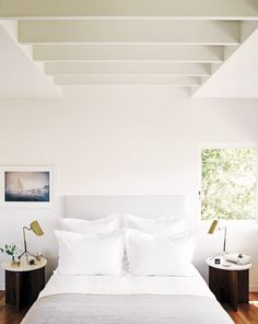 White bedroom with plush pillows