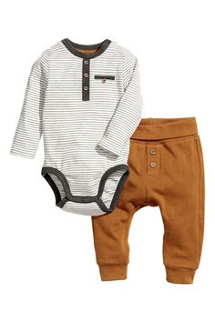Check this out! CONSCIOUS. Bodysuit and pants in organic cotton fabric. Long-sleeved jersey bodysuit with decorative button placket, mock chest pocket, and snap fasteners at shoulders and at gusset. Lightweight sweatpants with foldover ribbing at waist, mock fly with decorative buttons, and ribbed hems. - Visit hm.com to see more.