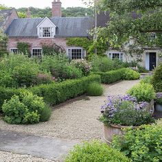We love the garden of this thatched, 18th-century farmhouse in Wiltshire, looked…