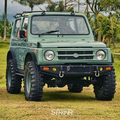 Green suzuki samurai tin top