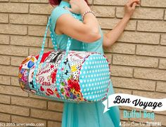 Sew Can Do: Ooh La La! It's The Bon Voyage Duffel Bag Tutorial featuring the new Oh La La fabrics from @sewtimeless.  Zipper topped, footed bag is perfect for looking chic while you travel.  The perfect weekender bag!