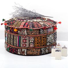 Bohemian Patchwork Pouf Ottoman, Vintage Indian Pouf In Black Color. I LOVE this, but Hammer would chew all of the shells and tassels off in a heartbeat.