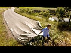 http://www.ted.com  - Erik Johansson creates realistic photos of impossible scenes -- capturing ideas, not moments.