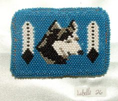 """Belt Buckle Native American Beadwork Blue Wolf w eagle feathers 3.5x2.5"""" New Native American made with wolf and two eagle feathers. Beadwork is sewn over a sturdy metal buckle with a leather backing.  A one of a kind piece.  New.  #beltbuckle #wolf #nativeamerican"""