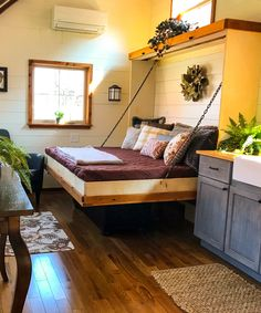 Inside the Highland is a queen size Murphy bed in the living room and a loft that can be used as a second bedroom, office space, or storage.