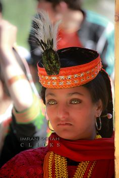 Pakistan | Kalash girl at Joshi festival, Chitral, northern Pakistan.  Amazing Eyes!! These people are thought to be descendants of Alexander's the Great army.