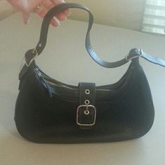 Coach Authentic black leather coach purse in great condition shoulder bag comes from a smoke free and clean home has only been used a couple of times Coach Bags Shoulder Bags