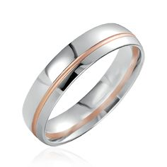 Cette alliance prestige est en or blanc et rose. Sa finition polie lui apporte une touche d'élégance. http://www.zeina-alliances.com/alliance-breuning/2716-westly.html