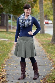 Already Pretty outfit featuring plaid scarf, navy sweater, olive green pleated skirt, Frye Vera Slouch boots