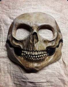Painted latex skull mask, one size fits most. Comes with strap. Caution: This product contains latex rubber which may cause an allergic reaction.