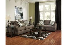 """The Corley - Slate Sofa from Ashley Furniture HomeStore (AFHS.com). The """"Corley-Slate"""" upholstery collection features uniquely shaped set-back arms and plush """"T"""" seat cushions surround beautifully within a soft textured upholstery fabric that adds comfort to the rustic Vintage Casual design while the stunning accent pieces complete this stylish collection."""