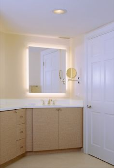 Beige Vanity With White Top And Gold Fixtures