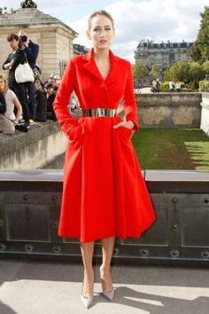 Leelee stunned in this tomato-colored Christian Dior Couture coat dress at the label's Spring 2013 show in Paris. For a summery twist on the look, try a red long-sleeved shirtdress instead. Click through to shop her look.