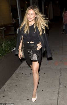 Hilary Duff shows off her sexy side in short thigh-high split skirt and chic leather jacket as she enjoys a late night dinner outing